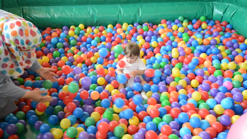 Baby playing in playground colorful ball pool