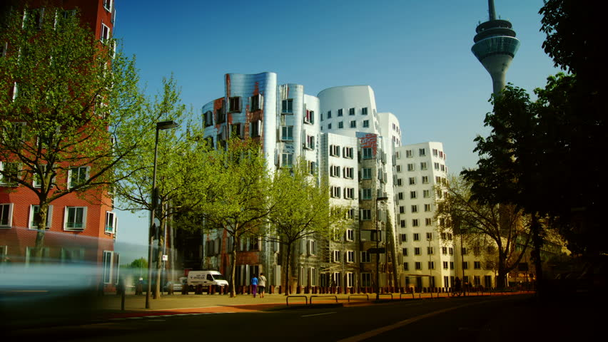 DUSSELDORF, GERMANY – May 8: Dusseldorf Harbor is home to some spectacular postmodern architecture,  with contemporary status symbols signifying corporate success: Frank Gehry.,May 8, 2013, - HD stock footage clip