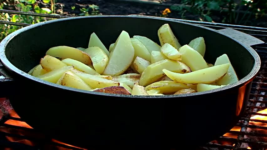 potatoes fried on fire - HD stock video clip