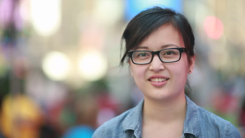 Young Asian woman smiling face in the city with copyspace