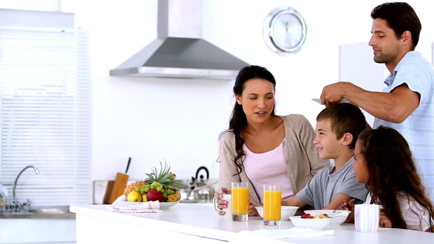 Family having breakfast together in the kitchen at home - HD stock footage clip
