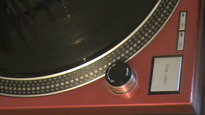 Close up of a vinyl deck playing a record - SD stock video clip