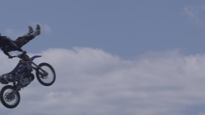 Motocross Jumper Doing Crazy Motorcycle Tricks silhouette