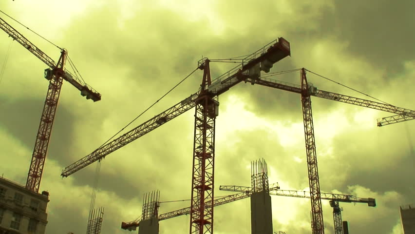 Large Construction Cranes : Large construction cranes timelapse stock footage