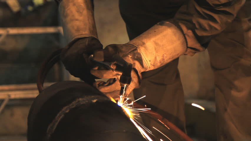 Industrial worker cutting steel by using metal torch. - HD stock footage clip