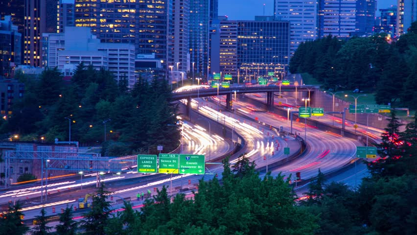 Time Lapse Close Up shot of Freeway Traffic at Twilight in Seattle, Washington, USA. Highway 5 traffic in long exposure. Photo Sequence shot on DSLR camera