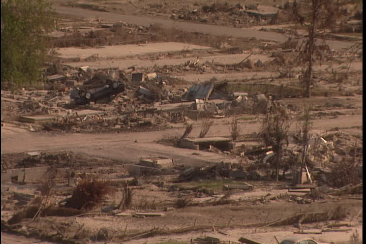 Leveled and barren neighborhood  in New Orleans after Hurricane Katrina (October 2005), camera zooms out