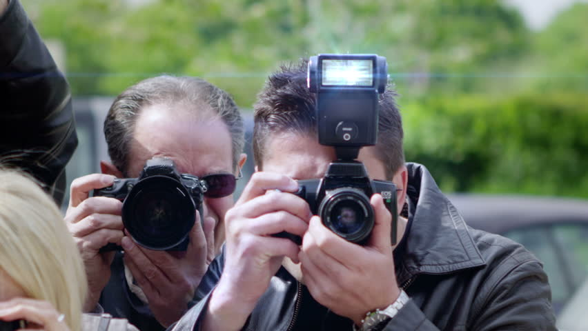 Celebrity Being Photographed By a Large Group of Paparazzi - HD stock video clip