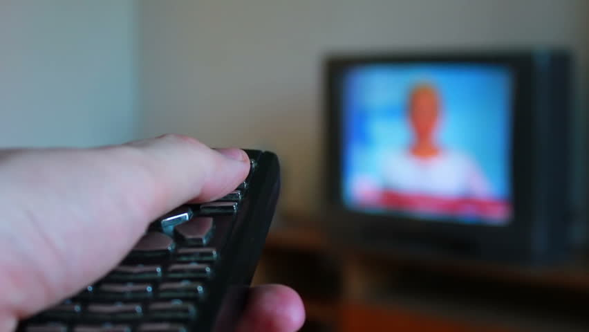 human hand changes the channels on the TV remote control  - HD stock footage clip