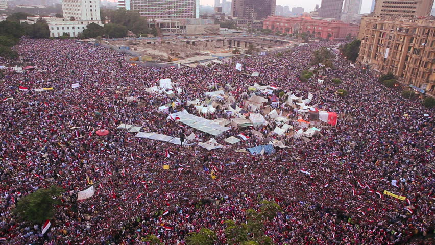 CAIRO, EGYPT - 2013: Crowds gather in Tahrir Square in Cairo, Egypt.