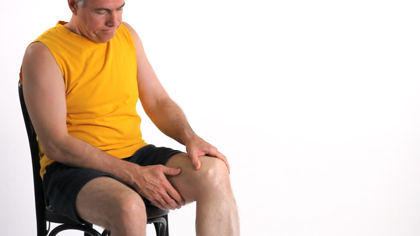 A man who is experiencing severe pain in his knee. - HD stock video clip