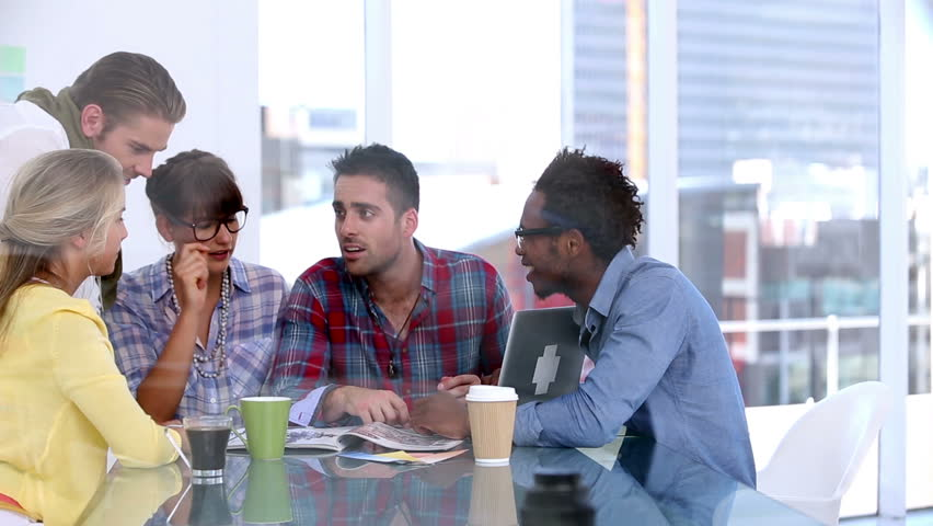 Colleagues brainstorming together in bright office