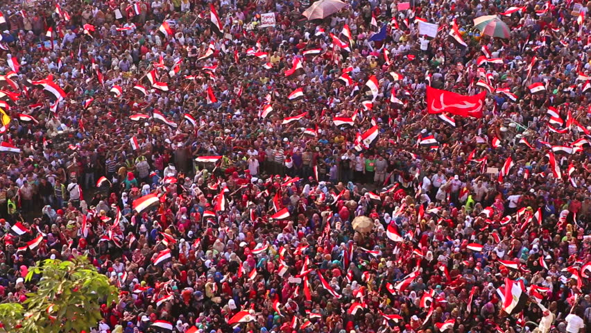 CAIRO, EGYPT - CIRCA JULY 2013: Protestors jam Tahrir Square in Cairo, Egypt following the coup that removed Morsi from office.