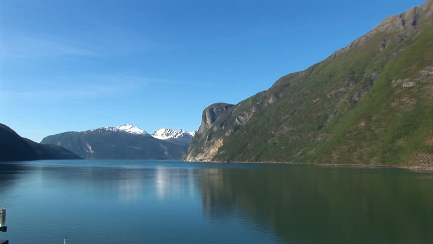 Sailing through the fjords of norway on a sunny summer day for Define scandinavian