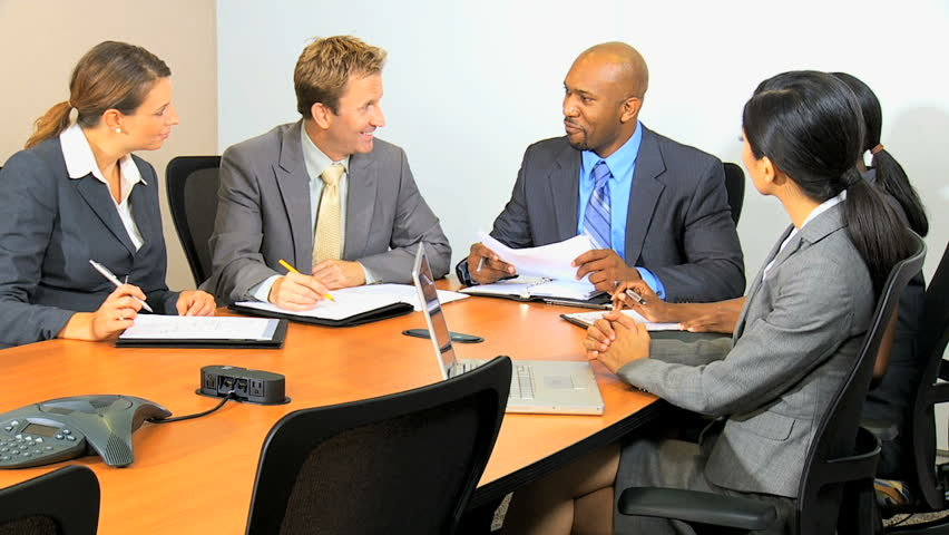 Male African American business executive leading meeting multi ethnic consultancy team