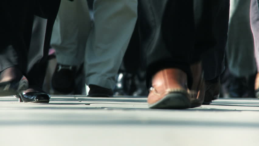 Closeup feet of city commuters in slow motion
