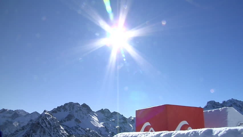 snowboarder jumps through sun in the blue sky - HD stock footage clip