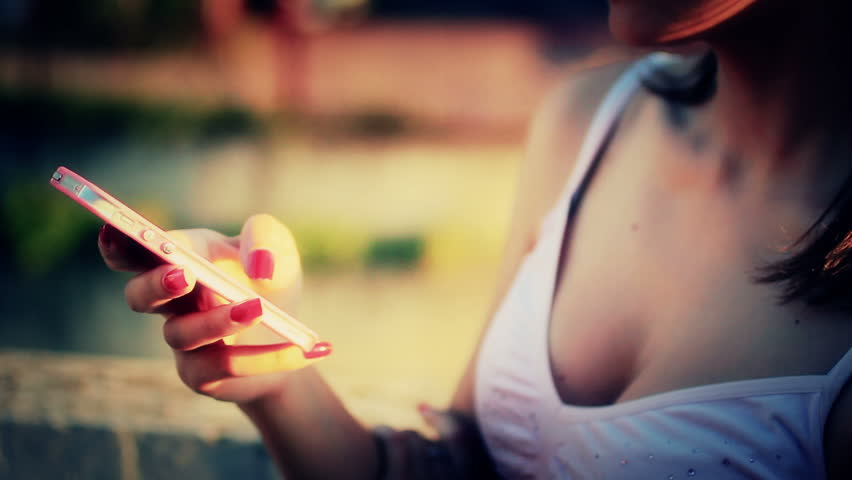 Young woman using mobile phone - Smartphone - HD stock footage clip