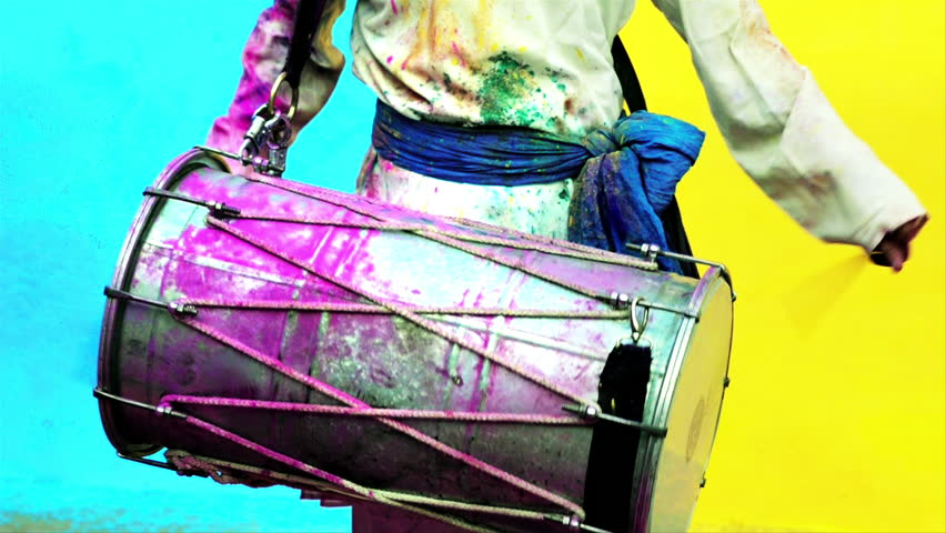 Locked-on shot of a man playing dhol during holi festival - HD stock footage clip