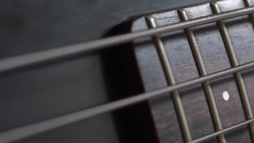 close up of bass guitar string vibrating stock footage video 4347992 shutterstock. Black Bedroom Furniture Sets. Home Design Ideas