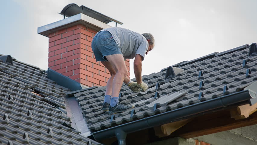Fixing Roof Tiles After Hail Storm Destroyed Roof Tiles