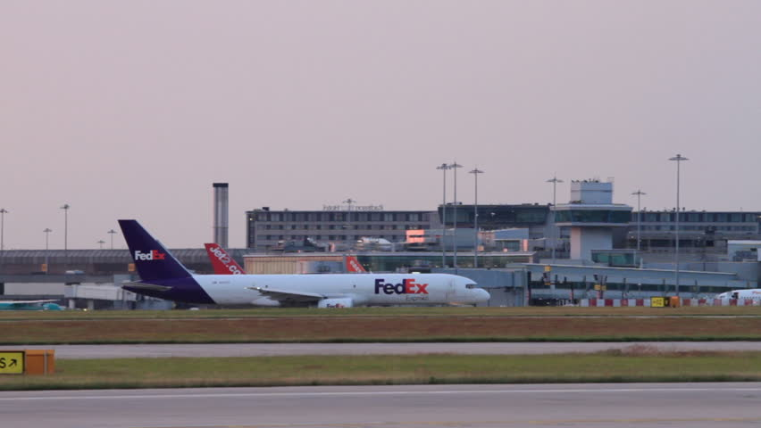 MANCHESTER, LANCASHIRE/ENGLAND - JULY 17: Fedex Boeing 757, plane taxis at sunset for take off on July 17, 2013 in Manchester. FedEx Express is a cargo airline based in Memphis Tennessee.