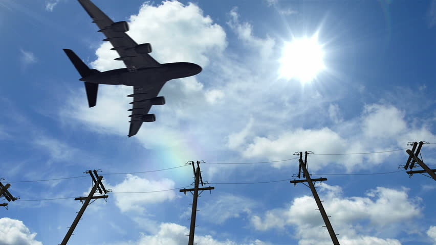 Airplane fly by sunny day blue sky. Aircraft passing by