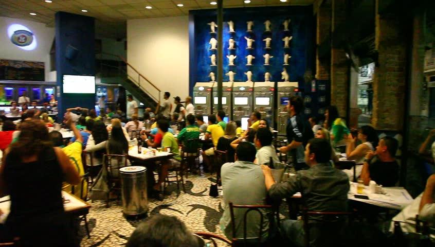 RIO DE JANEIRO, BRAZIL - JUNE 30: GOL! Cariocas (residents of Rio) in pub cheer their team as Brazil wins the Confederations Cup against Spain 3:0. Rio de Janeiro, Brazil, June 30, 2013.