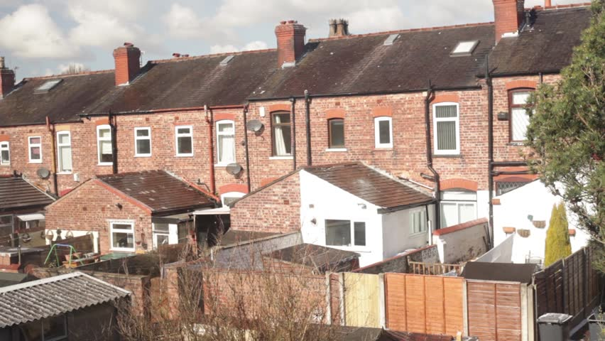 Terraced backyards on a sunny breezy day in Salford, Manchester