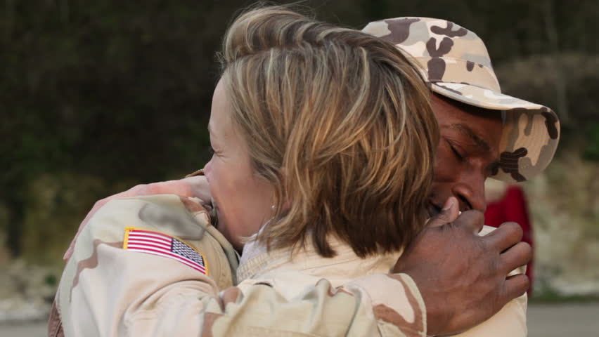 Army soldier returning home to the embrace of his wife