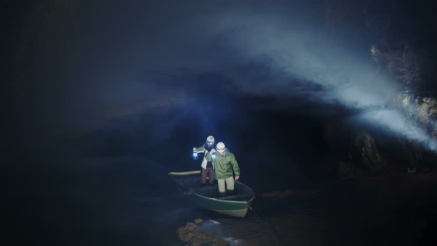Scientists and miners exploring dark caves. Geologists, explorers, adventurers, potholing, historians or mining company.