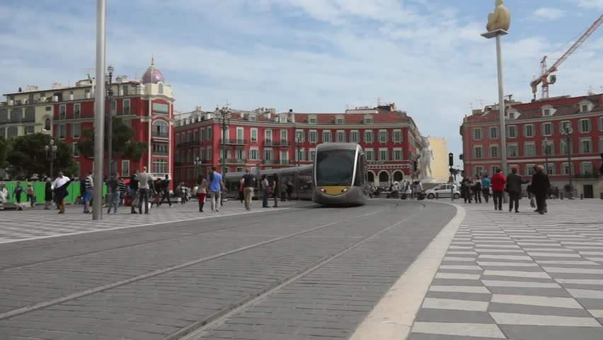 NICE, FRANCE - APRIL 27: Modern tram in the center of Nice, France on April 27, 2013. Central Square - Place Massena, new landmark of the town. It was reconstructed in 1979.