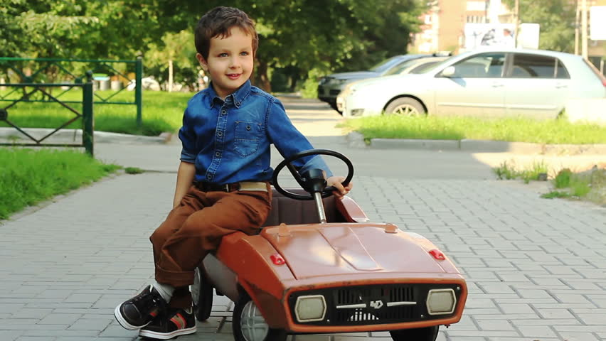 Toy Cars For 1 Year Old Boy : Young boy in front of lemonade stand stock footage video