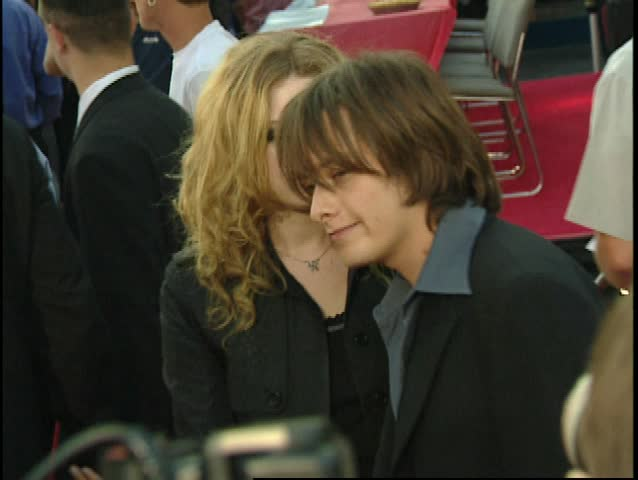 UNIVERSAL CITY - July 7, 1999: Natasha Lyonne and Edward Furlong at the American Pie Premiere in the Universal CityWalk Cineplex Odeon in Universal City July 7, 1999 - SD stock video clip