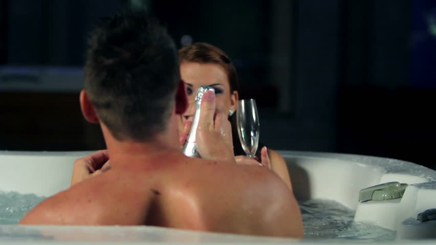 couple in jacuzzi spending romatic time together - HD stock footage clip