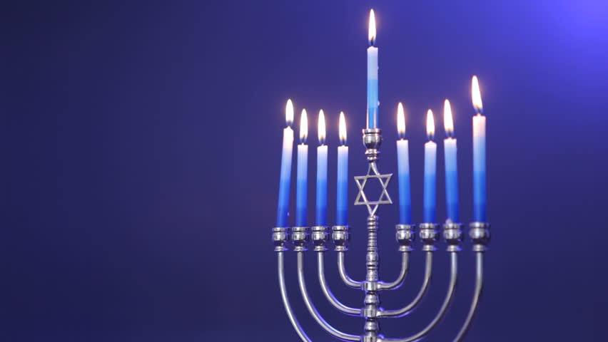 Traditional Jewish Menorah with candles lit