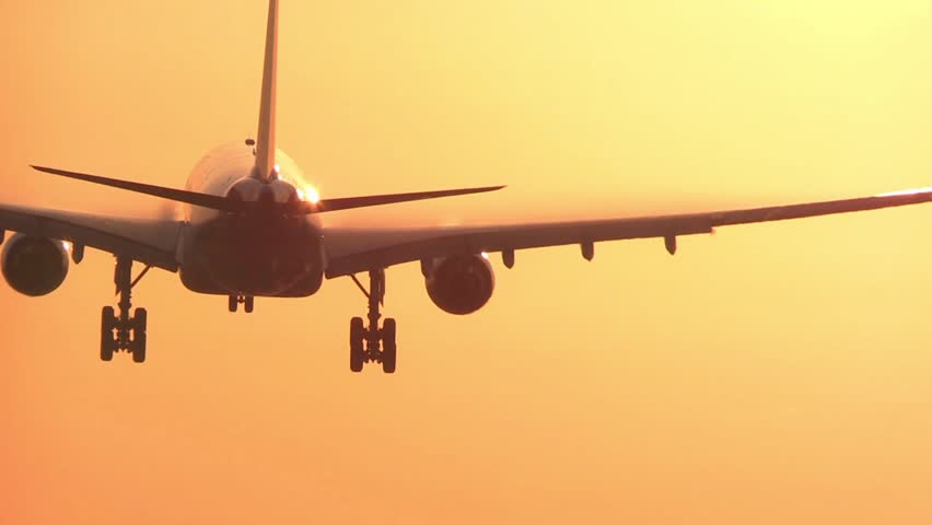 Big airplane landing at sunrise