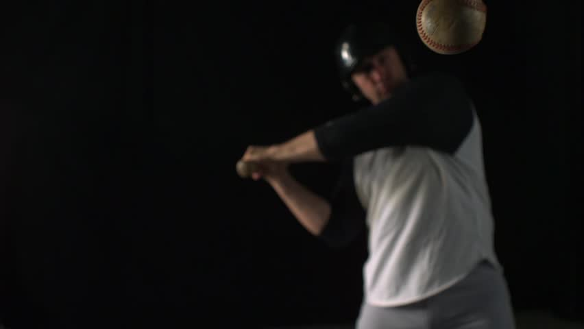 Baseball player hitting ball with bat shooting with high speed camera, phantom flex.