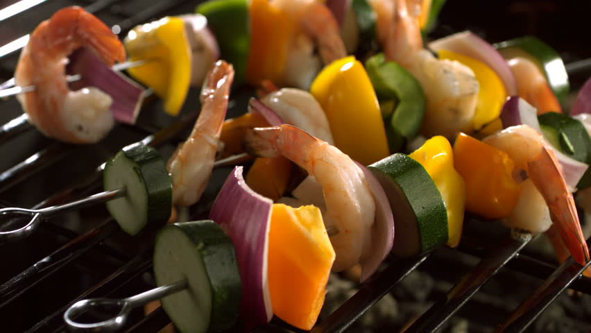 Shrimp and vegetable skewers on barbecue grill