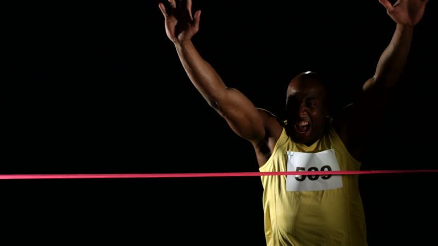Track athlete crossing finish line, slow motion
