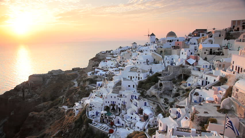 Sunset over the Aegean Sea viewed from the beautiful town of Oia on the Island of Santorini, Greece, Europe - HD stock footage clip