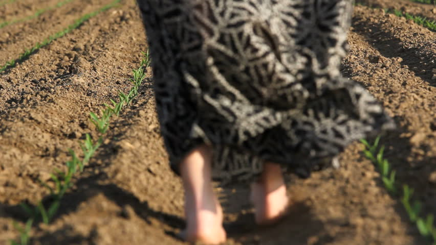 Woman feet step barefoot on spring soil long skirt in for Soil young s modulus
