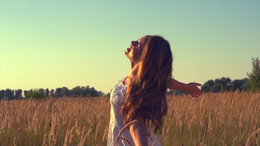 Beauty Girl with Healthy Long Hair Outdoors. Happy Smiling Young Woman Enjoying Nature. Beautiful Young Woman having Fun in the Meadow. Freedom concept. Sunset - HD stock video clip