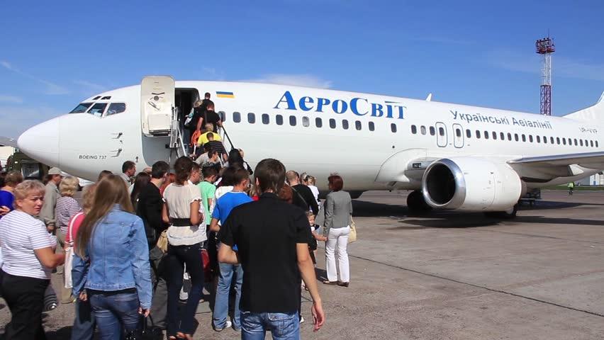 UKRAINE, BORISPOL, SEPTEMBER 22, 2010: People boarding airplane in international airport Borispol, Ukraine, September, 22, 2010