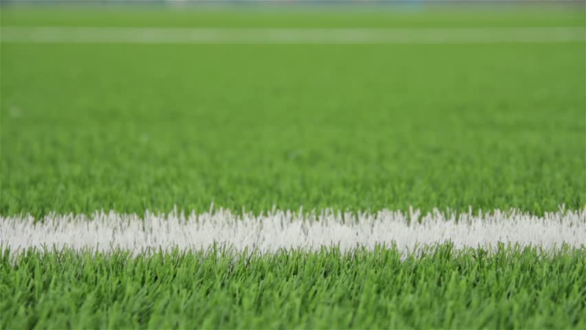 White line of the soccer field. Close-up horizontal slider shot