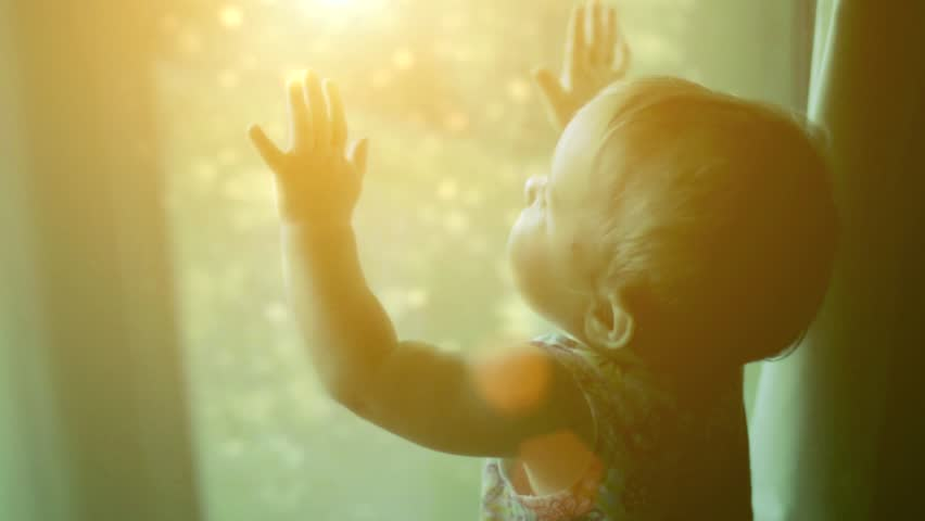 The child looks at the magic behind the window - HD stock footage clip