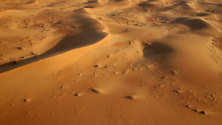 Aerial shot of sand dunes at sunrise, Arabian Dessert, Dubai, UAE