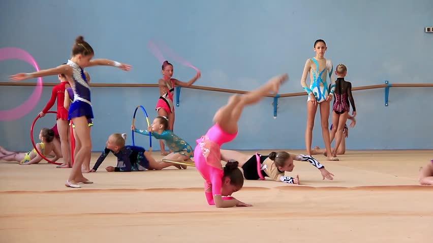 KIEV, UKRAINE, JUNE 9, 2012: Young girls gymnasts in gym at final examination in Deriugina school in Kiev, Ukraine, June 9, 2012