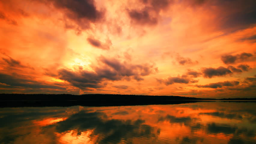 Apocalyptic sunset and clouds over forest  lake, timelapse - HD stock footage clip
