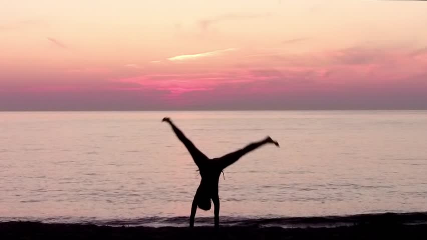 young gymnast in sunset
